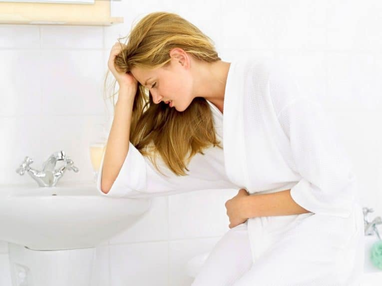 Тошнота после месячных: основные причины и лечение